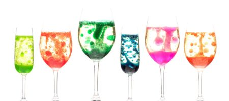 Wine glasses with bubbling blob experiment in different colors