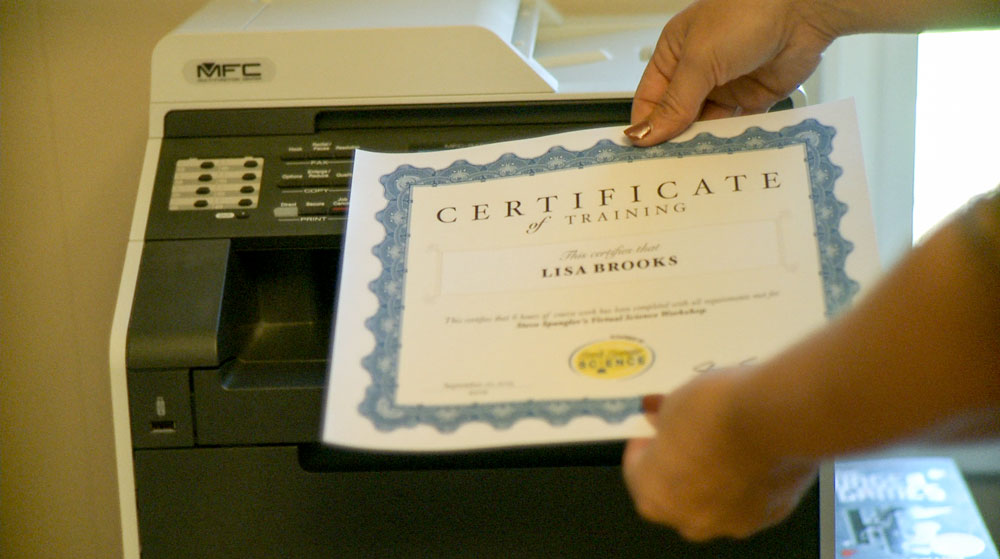 Teacher printing off a Virtual Science Workshop certificate