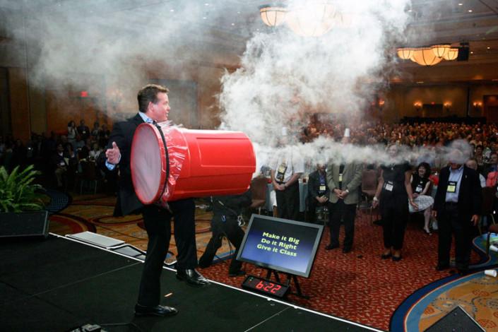 Steve Spangler at corporate keynote launching smoke rings