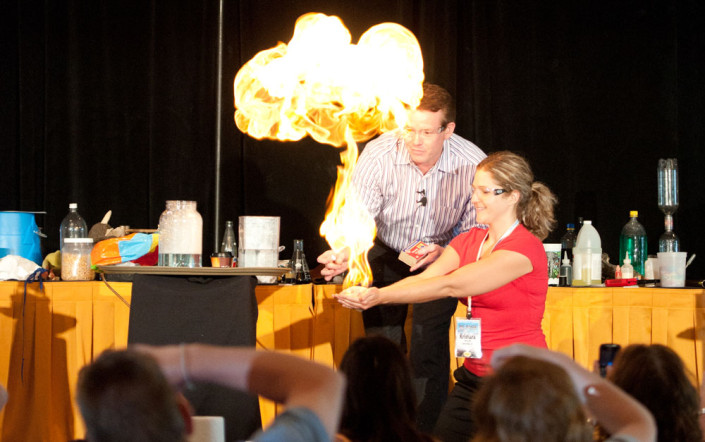 Steve Spangler doing fire bubbles with Teacher on stage during workshop