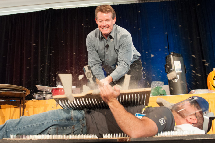 Steve Spangler during Science in the Rockies crushing cinder block on bed of nails